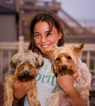 Girl with two puppies